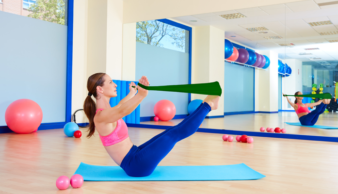 Lady using the green band for resistance training